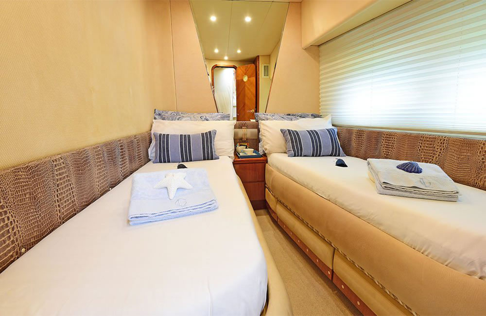 Bright twin bed suites with desk, mirror, side window for amazingness view to sea in this yacht tour
