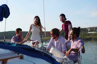 Friends having fun on yacht trip near Dubai coastline