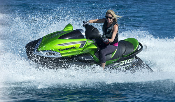 Blonde Girl enjoy riding green black Yamaha Waverunners Jet Ski 1800cc from Jet Ski rentals in Dubai